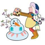 Flicka som bygger en snowman Arkivfoto