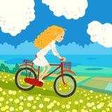 Flicka som cyklar på ängen Royaltyfria Foton