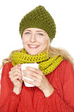 Flicka som dricker varm grog Royaltyfria Bilder