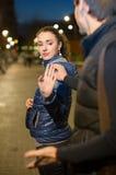 Flicka som frågar mannen att stoppa besvära Fotografering för Bildbyråer