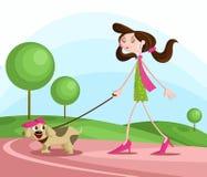 Flicka som går med hunden Royaltyfri Bild