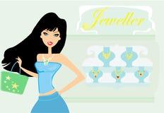Flicka som gör shopping i ett smyckenlager Arkivfoton