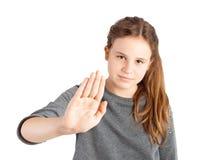 Flicka som gör stoppet att göra en gest Arkivbild