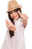 Flicka som gör upp tummar royaltyfri fotografi