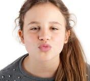 Flicka som ger kyssen Fotografering för Bildbyråer
