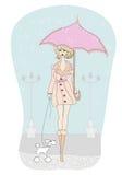 Flicka som går med hennes hundkapplöpning i regn Arkivbild