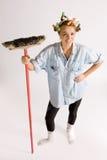 flicka som houseworking arkivfoto