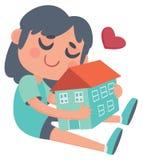 Flicka som kramar ett hus Royaltyfria Bilder