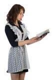 Flicka som läser en bok Fotografering för Bildbyråer