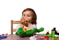 Flicka som leker som doktor med henne toys 2 royaltyfri fotografi