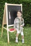 flicka som little lärer fotografering för bildbyråer