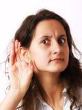 flicka som lyssnar Royaltyfri Fotografi
