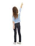 Flicka som pekar fingret på något som är osynlig Royaltyfri Fotografi