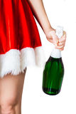 Flicka som rymmer en flaska av champagne Arkivfoto