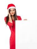 Flicka som rymmer en stor bråklista för jul Royaltyfria Bilder