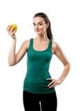 Flicka som rymmer ett gult äpple Royaltyfri Foto