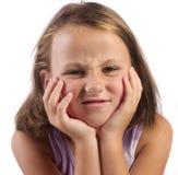 Flicka som scrunching henne framsida Fotografering för Bildbyråer