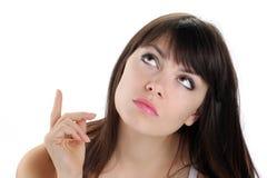 Flicka som ser och pekar med ögon arkivbilder