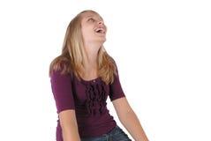flicka som skrattar se tonårs- uppåtriktat för studio arkivbilder