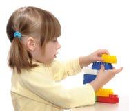 Flicka som spelar med kvarter arkivbild