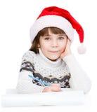 Flicka som tänker vad för att skriva i en bokstav till Santa Claus isolerat Arkivbilder