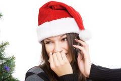 Flicka som talar på telefonen som isoleras på vit bakgrund Fotografering för Bildbyråer