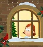 flicka som ut ser fönstret Arkivfoto