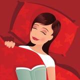 Flicka sovande i säng Arkivfoto