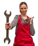 Flickaarbetare med skiftnyckeln Fotografering för Bildbyråer