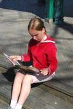 flickaavläsningsbarn Royaltyfria Bilder