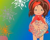 Flickabarnjul räcker gåvasjalen, lycklig ferie Arkivfoto