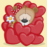 Flickabjörn i hjärtor Arkivfoton