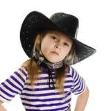 Flickacowboy i en svart hatt Royaltyfri Fotografi