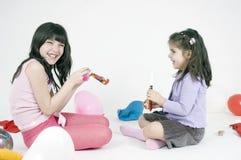 flickadeltagare Arkivfoto