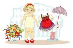 Flickadocka med kläder Royaltyfria Bilder