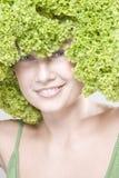 flickafrisyrgrönsallat Arkivbild