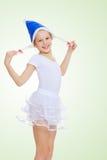 Flickagymnasten i huven Santa Claus Arkivbilder