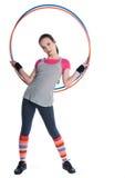 flickagymnastik som rymmer cirklar arkivfoton