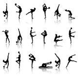 flickagymnastsilhouettes Arkivfoto