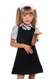 flickahår isolerade fjuttig uniform white för liten elevskolastudio Arkivfoto
