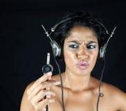 flickaheadphone Fotografering för Bildbyråer