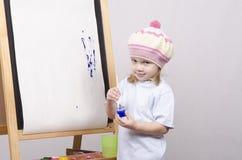 Flickakonstnärmålarfärger på kanfas Arkivbild