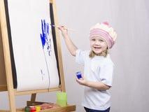 Flickakonstnärmålarfärger på kanfas Royaltyfri Fotografi