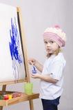Flickakonstnärmålarfärger på kanfas Arkivfoto