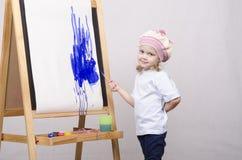 Flickakonstnärmålarfärger på kanfas Arkivbilder