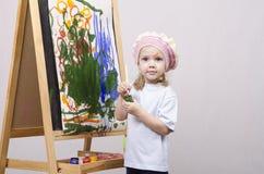 Flickakonstnärmålarfärger på kanfas Arkivfoton