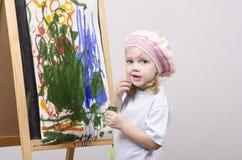 Flickakonstnärmålarfärger på kanfas Royaltyfri Foto
