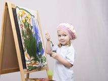 Flickakonstnärmålarfärger på kanfas Fotografering för Bildbyråer