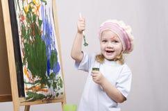 Flickakonstnärmålarfärger på kanfas Royaltyfria Foton