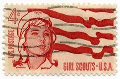 flickan 1962 spanar stämpeln Arkivfoto